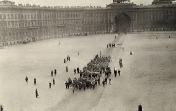 "Members of the WWI women's ""Battalion of Death"" march across a square."